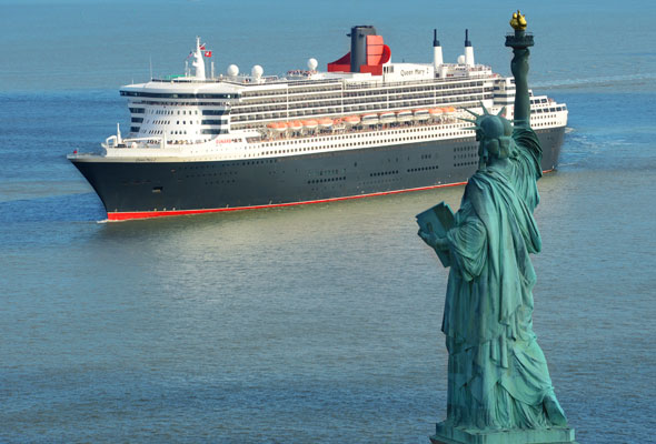 Queen Mary 2 sailing past the Statue of Liberty