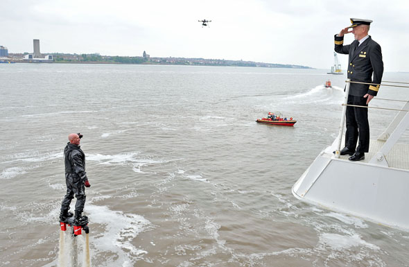 Commodore Christopher Rynd exchanges salutes with Fly-boarder Jay St John, Liverpool - must credit Jason Roberts, Liverpool Echo IMG_0196