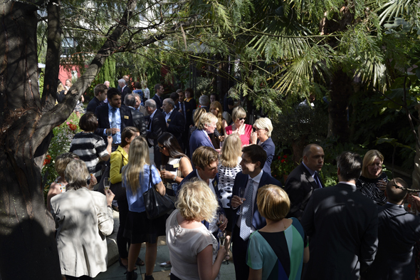 Guests enjoying the sunshine in the Spanish Garden at Kensington Roof Gardens