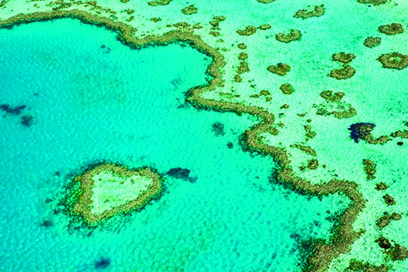 Australia, Queensland, Whitsundays, Great Barrier Reef Marine Park. Aerial view of ^Heart Reef^, a heart-shaped coral formation at Hardys Reef