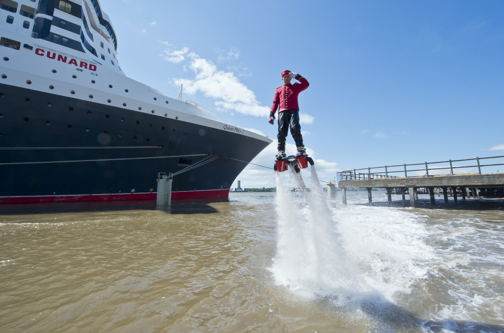 Flyboarder Jay St John, dressed as a bell boy to mark Cunard's 175 Anniversary in Liverpool