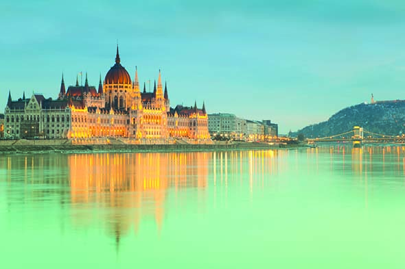 The imposing Hungarian parliament overlooking the Danube. Photo credit iStock