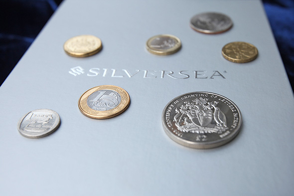 The seven coins, each representing a continent, that have been welded into the keel of Silver Muse