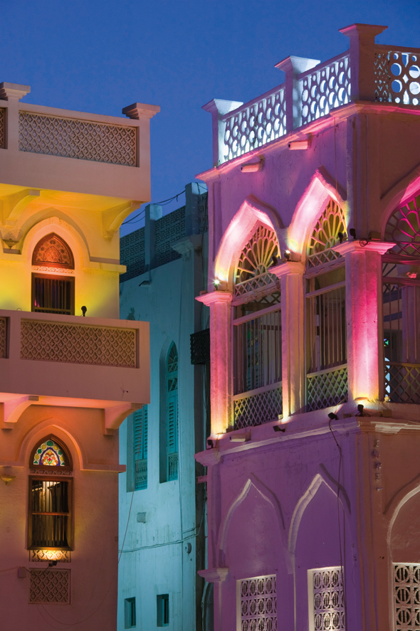 Illuminated buildings in Oman. Credit AWL Images