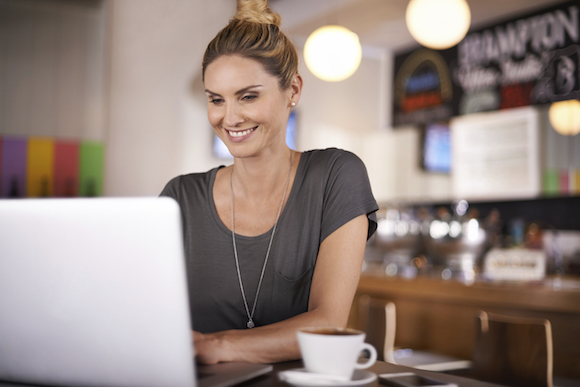 A beautiful woman using her laptop in a coffee shop