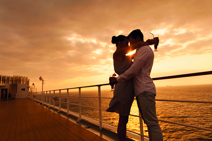 A couple enjoy a romantic cruise © Shutterstock