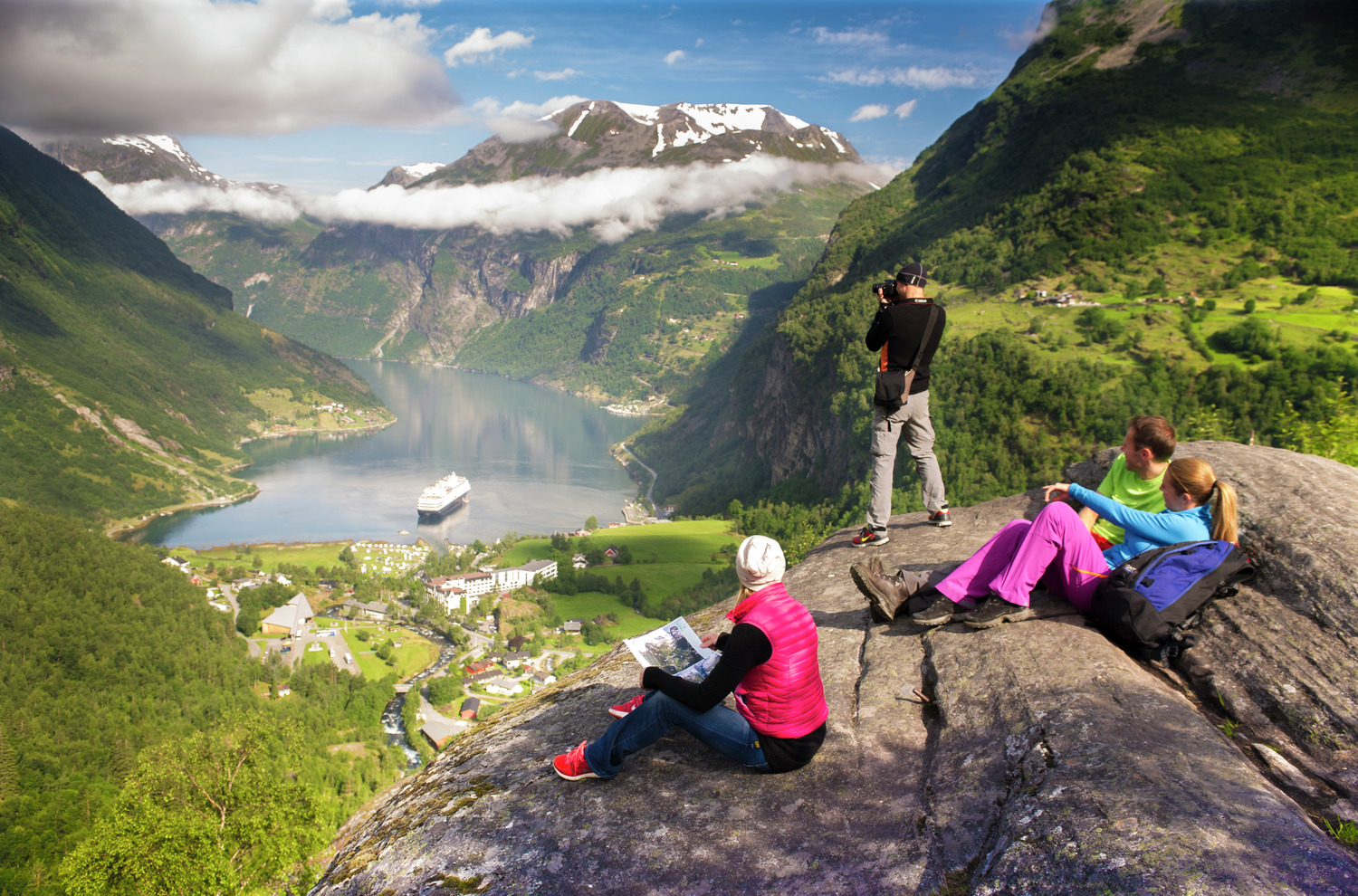 Hikers watch a cruise ship in Geirangerfjord © Visitnorway.com