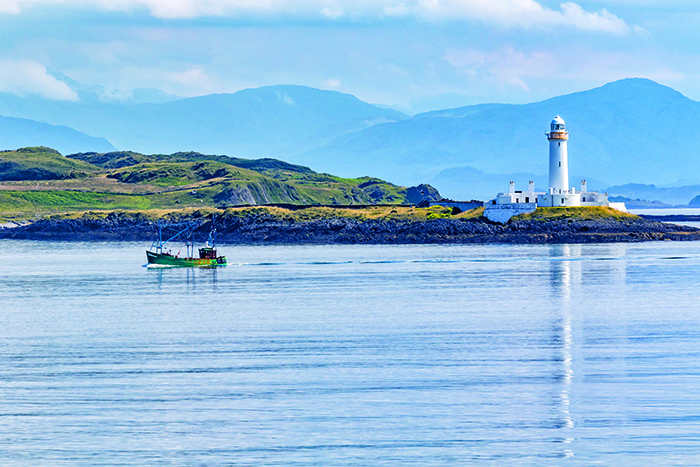 Eilean Musdile Lighthouse in the Inner Hebrides © iStock
