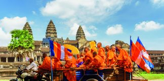 Buddhist monks travelling to ancient Angkor Wat in Siem Reap, Cambodia © iStock
