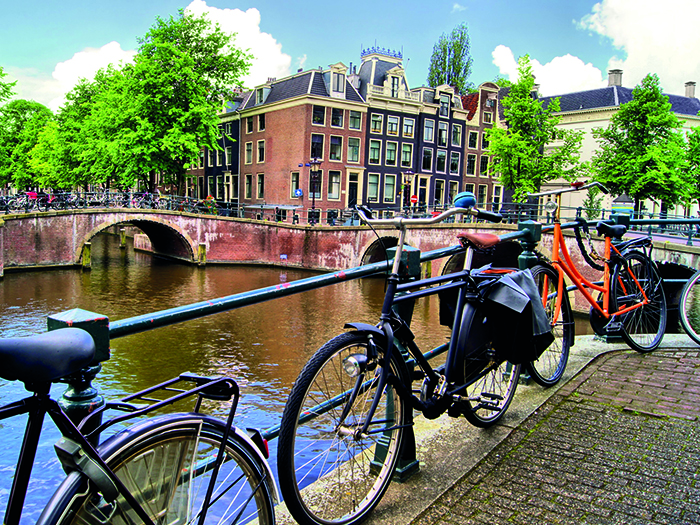 Amsterdam is famed for its bicycles and canals © iStock