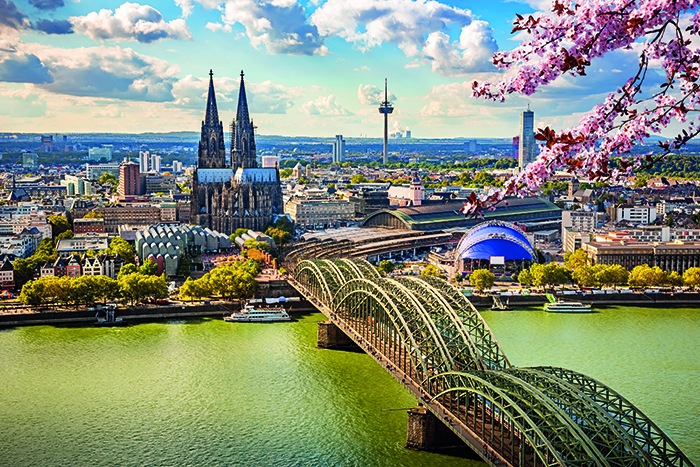 The Gothic cathedral and Hohenzollern Bridge in Cologne, Germany © iStock