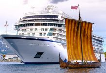 Viking Sky with a longship