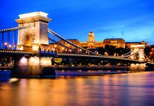The Chain Bridge and Buda Castle at night in Budapest, Hungary © Getty Images
