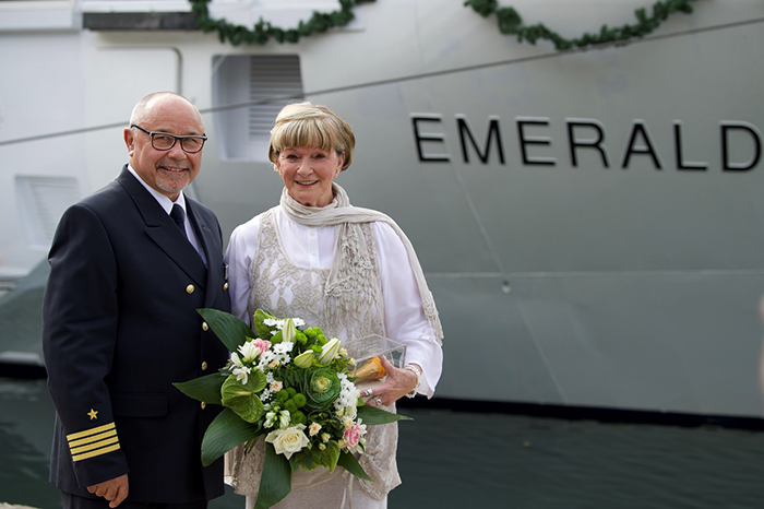 Captain Darrio Lelu and Godmother Maxine Collins at Emerald Liberté's christening in Lyon, France
