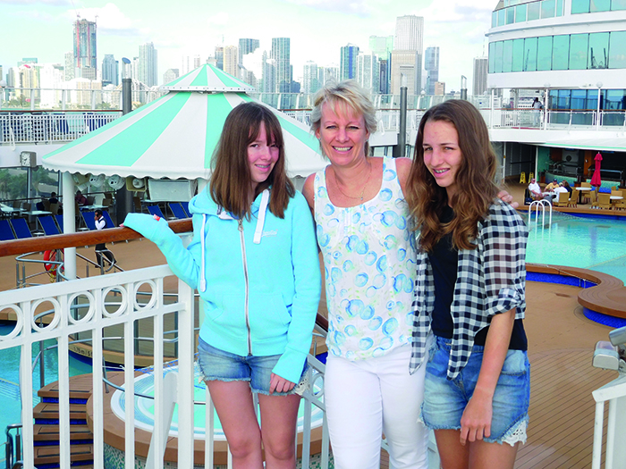 Sara with her 14-year-old twin daughters, Holly and Dani
