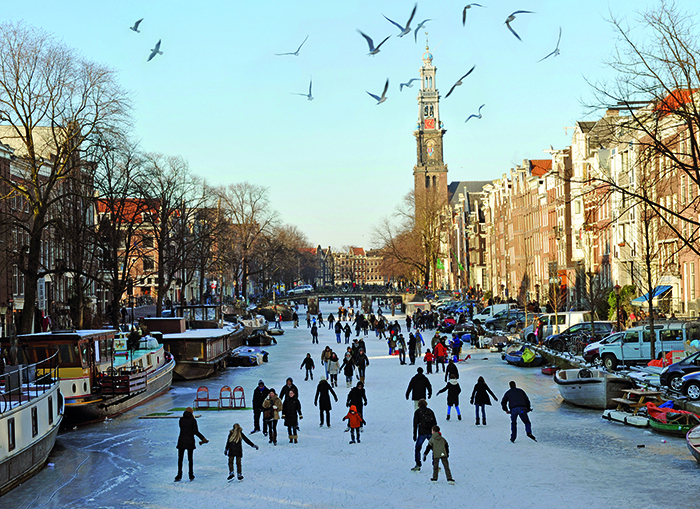 Ice skaters on the frozen Prince's Canal in Amsterdam © iStock