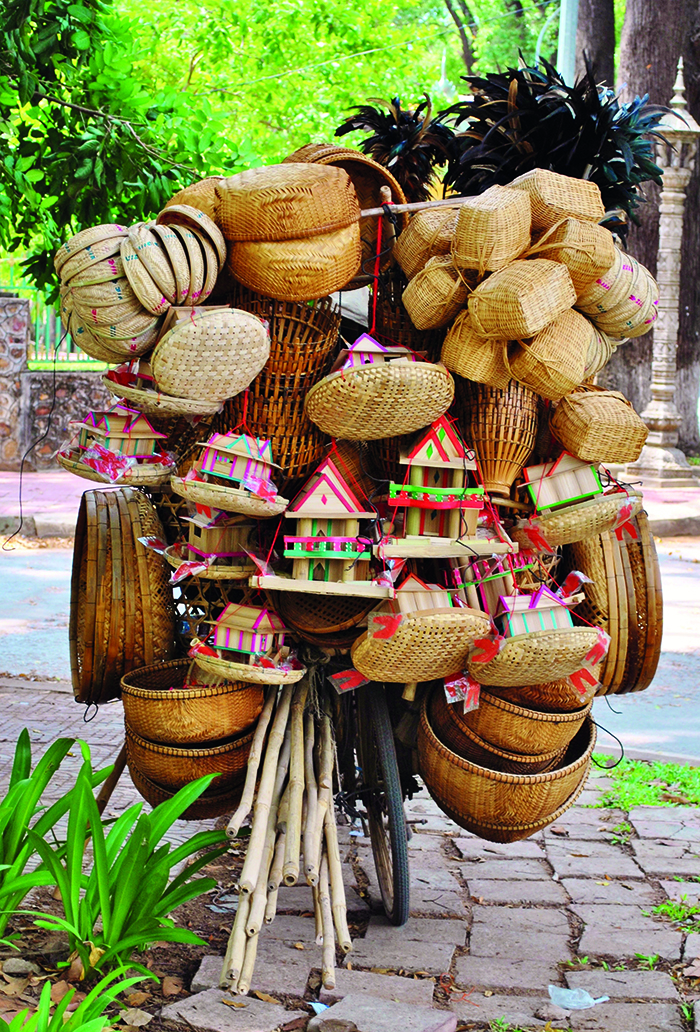 A bicycle piled high with wicker baskets in Cambodia © iStock