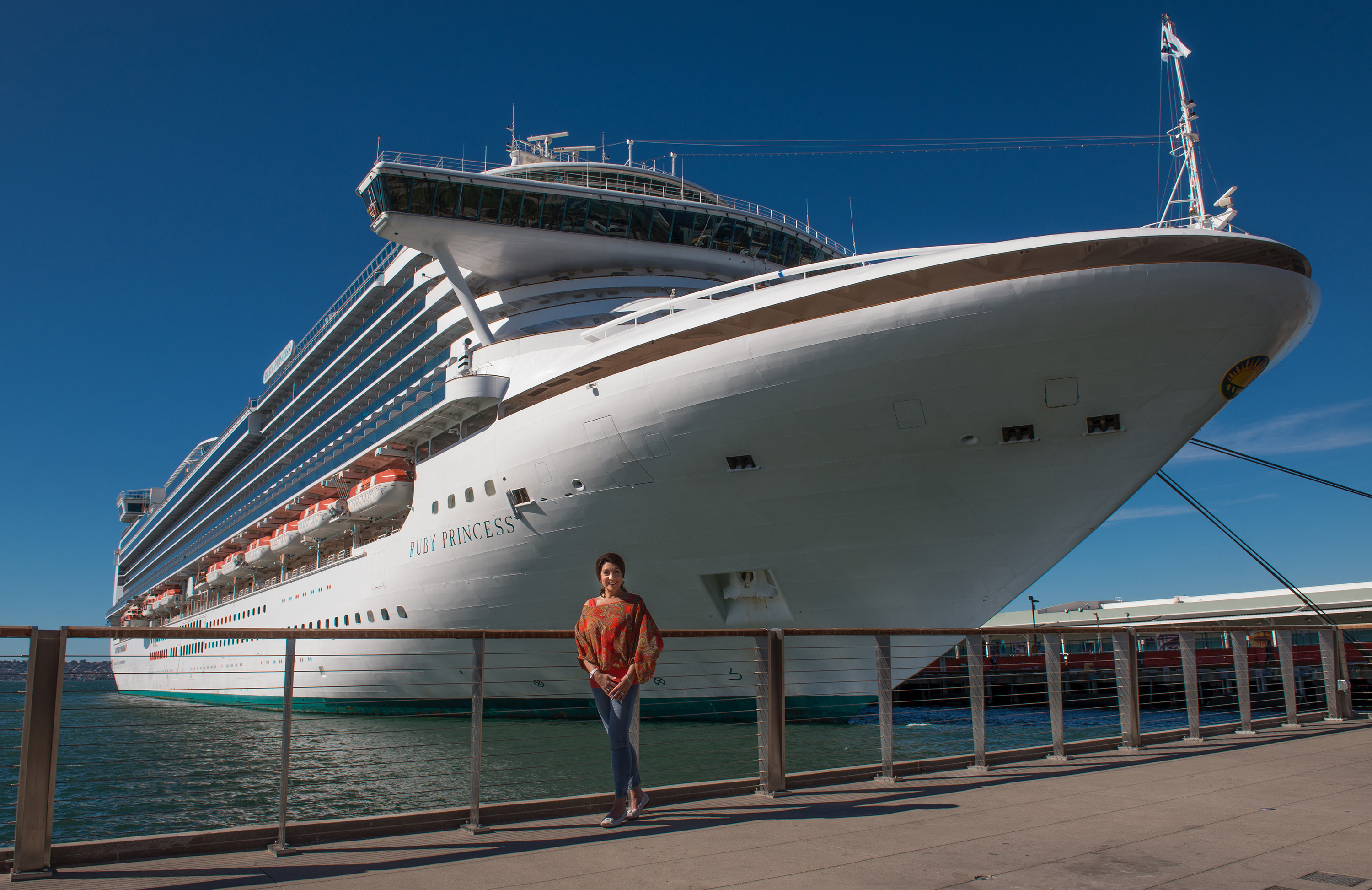 Jane McDonald in front of Princess Cruises' Ruby Princess. Photo by RobComeau.com for CH5 UK