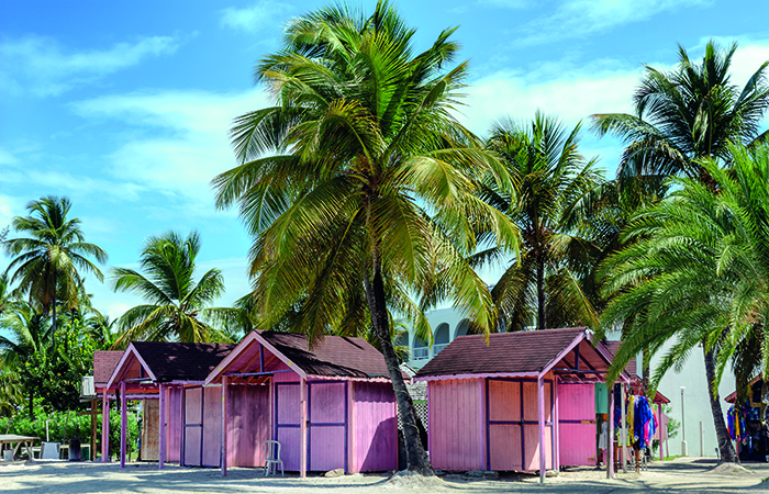 Colourful beach huts in Antigua © iStock