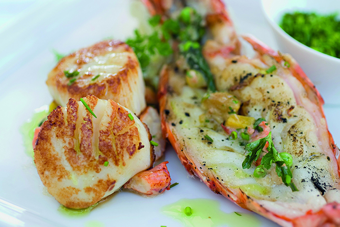 Fine dining with lobster tail and scallops © iStock