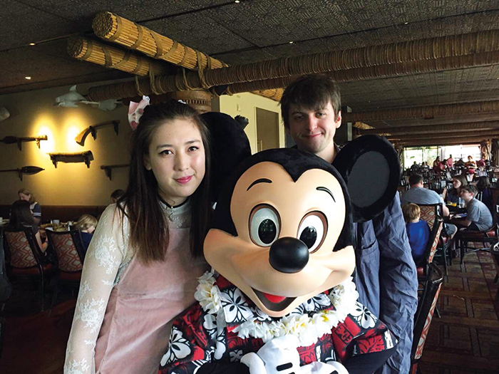 Robin and Oliver pose for a pic with the legendary Mickey Mouse