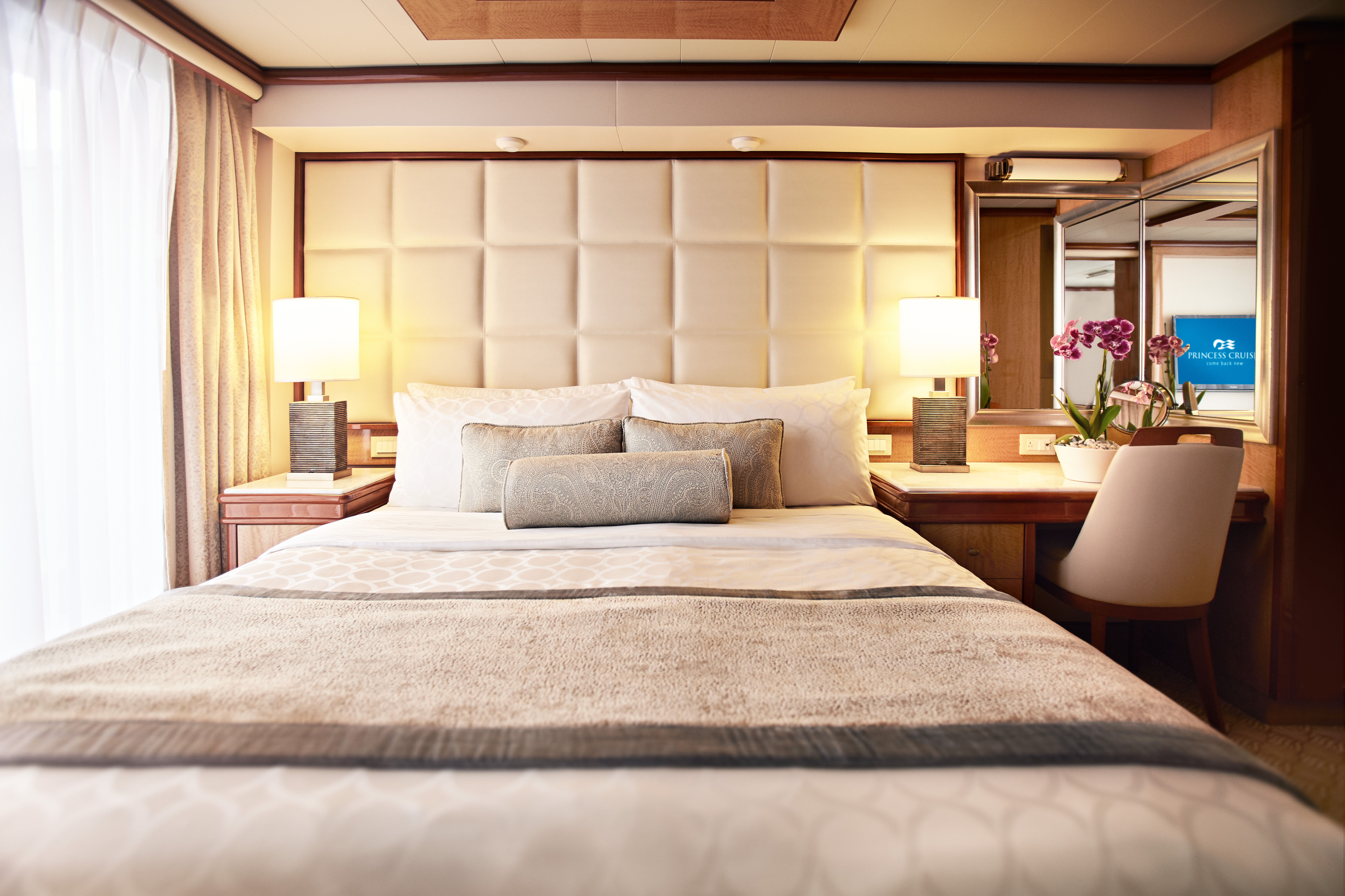 A luxury bed on board the refurbished Sapphire Princess