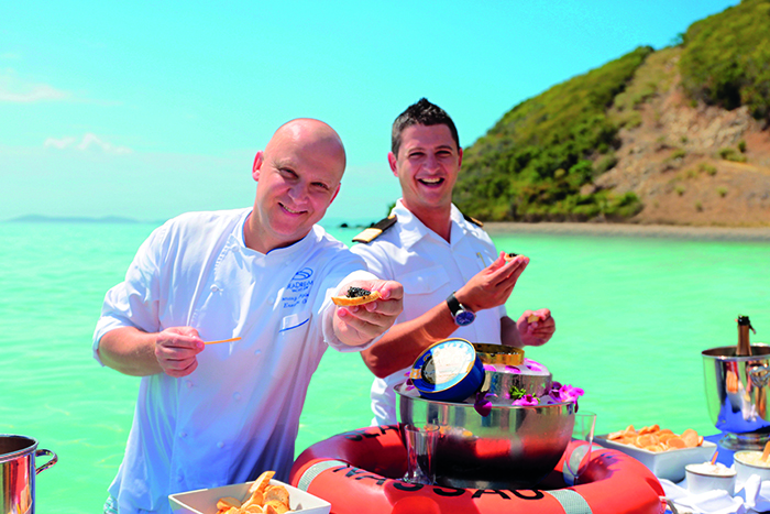 SeaDream's Chef Tomasz and a fellow crew member at the Champagne and Caviar Splash