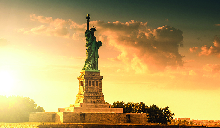 The Statue of Liberty, bathed in dawn light © iStock