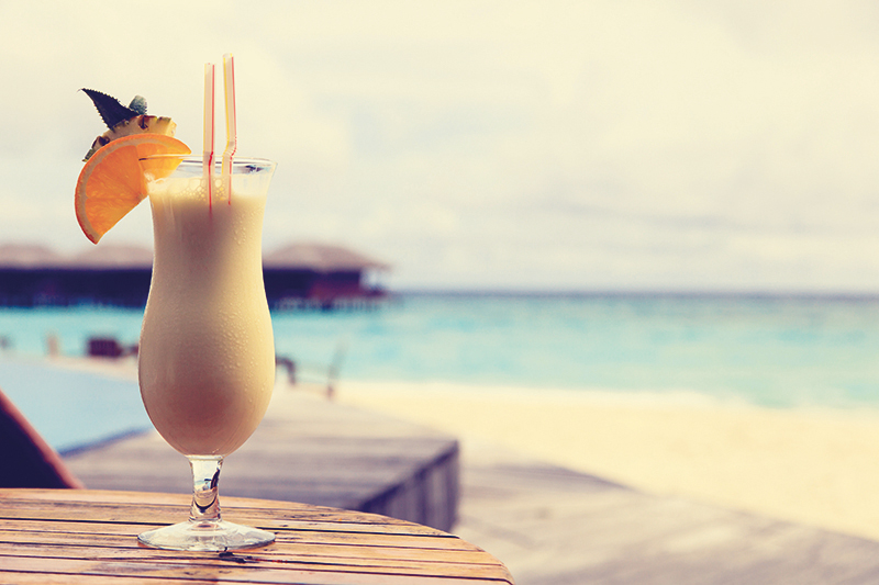pina colada on beach solo travel