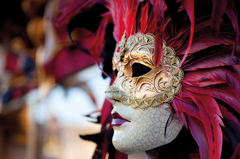 Red Venetian Carnival mask in Venice, Italy