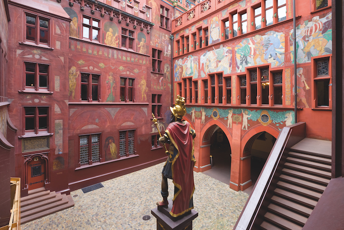 The ornate courtyard of the Basel town hall with the statue of Lucius Munatius Plancus