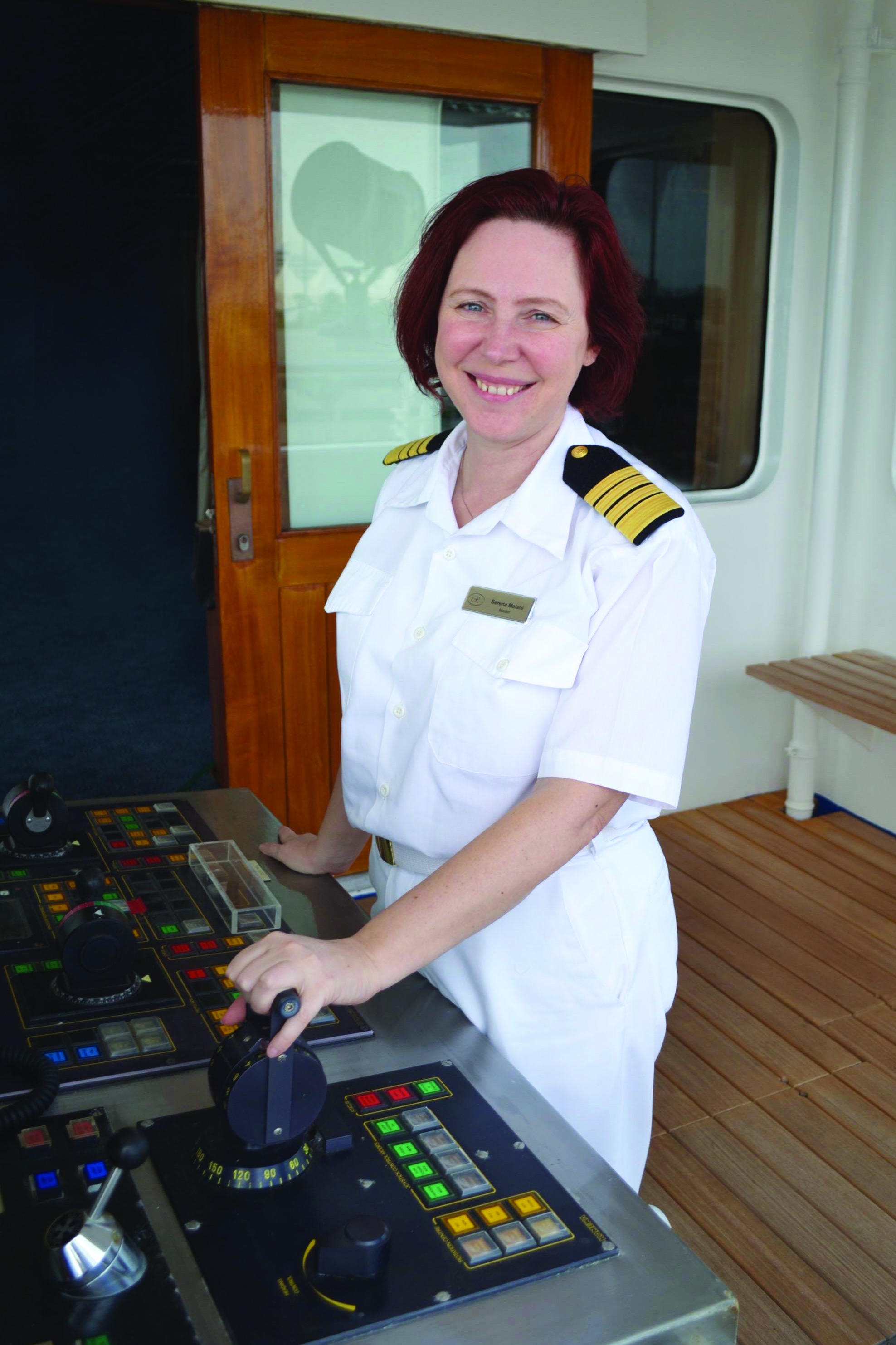 Captain Serena Melani at the helm of Regent Seven Seas Cruises cruise ship