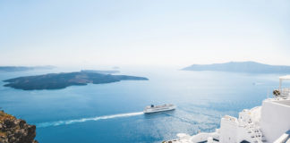 Savvy cruisers on a cruise ship passing Santorini in Greece