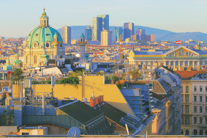 the sun sets over Vienna's skyline in Austria