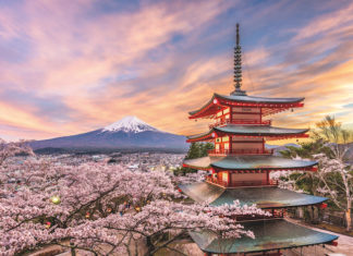 Fujiyoshida, Japan, at Chureito Pagoda and Mt. Fuji in the spring with cherry blossoms.