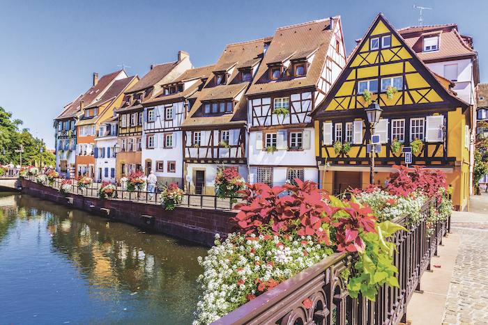 timbered houses line the Rhine river in France