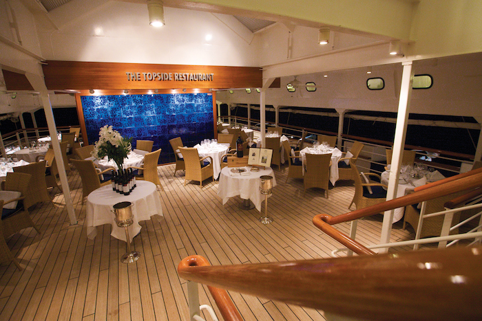 tables set up for dinner on the Topside Restaurant on board Seadream Spain cruise