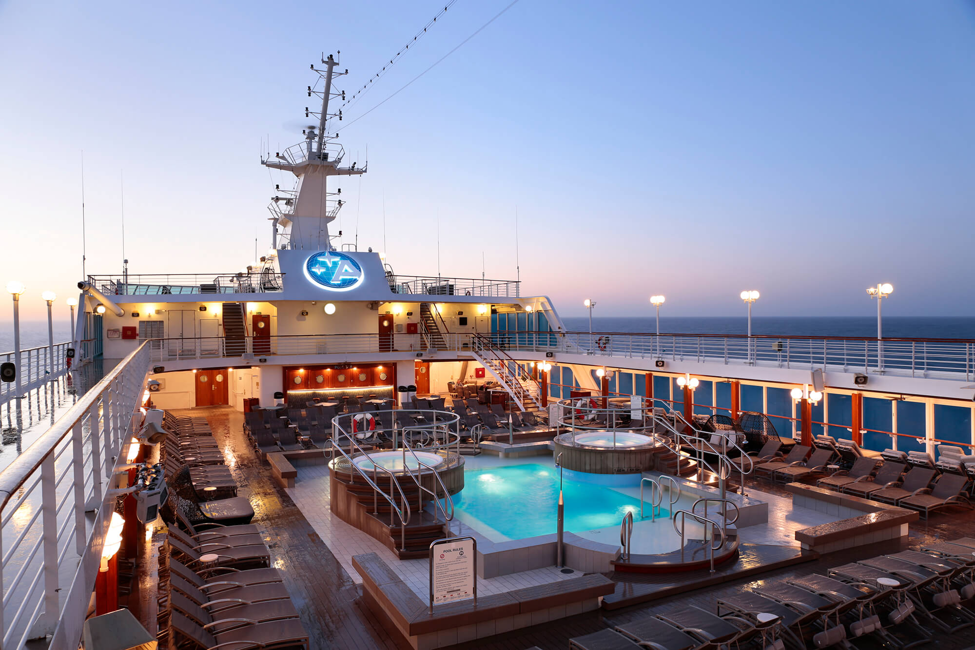 pool deck on Amazara Journey lights up at night
