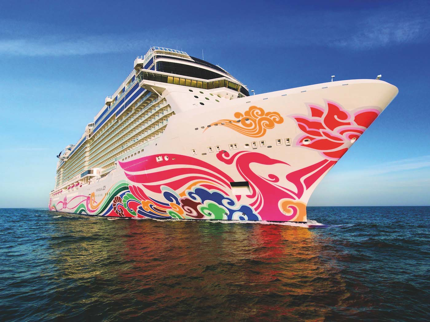 Norwegian Joy shows off colourful artwork on its hull