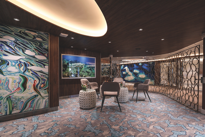The Naturalist Lounge in Darwin's Cove on board Celebrity Flora
