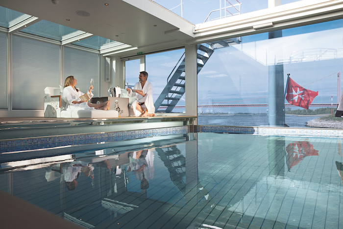 cruise guests relax next to the heated onboard pool on board Emerald Destiny