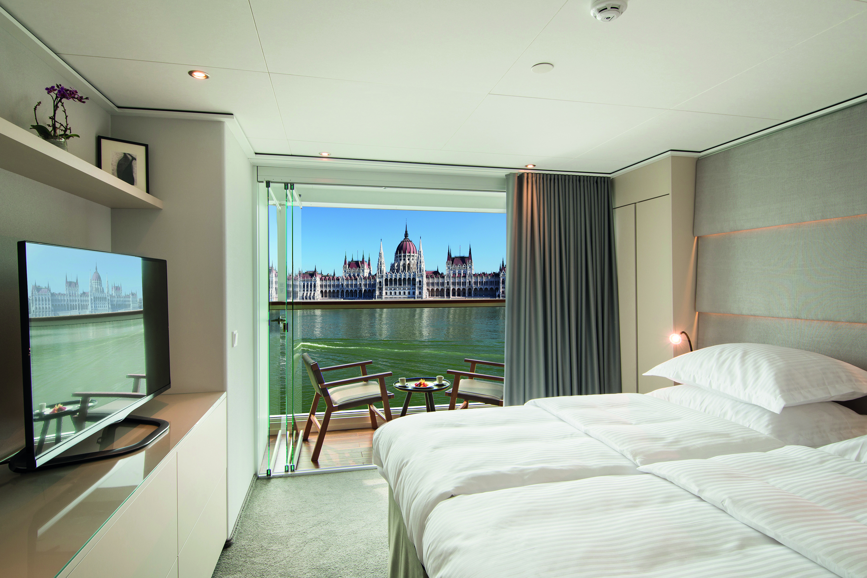 A Panorama Balcony Suite on board Emerald Destiny with views out across the Danube