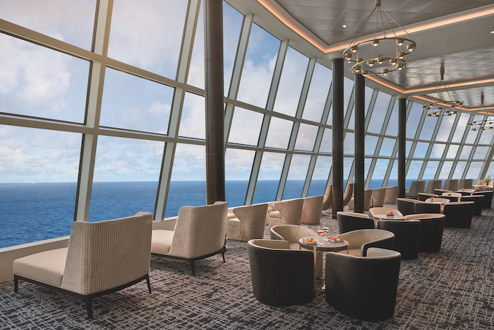 full-length windows and lots of seating in the Observation Lounge seen on a Norwegian Joy review
