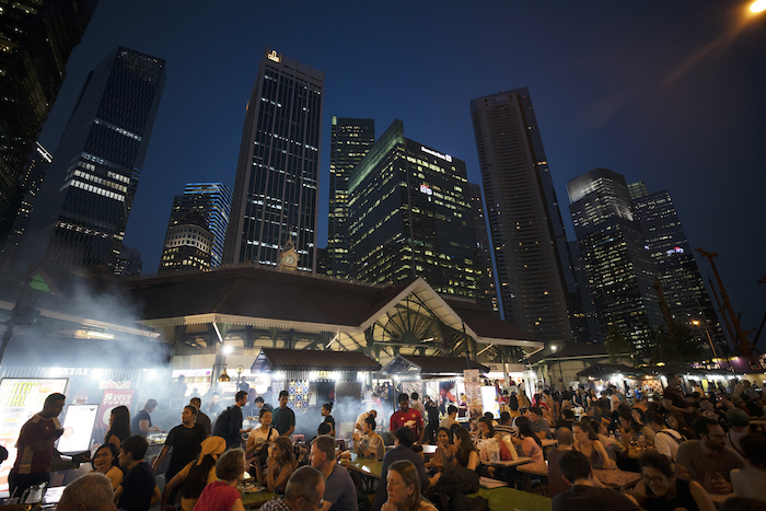 scores of people enjoy the food at a Hawker centre in Singapore