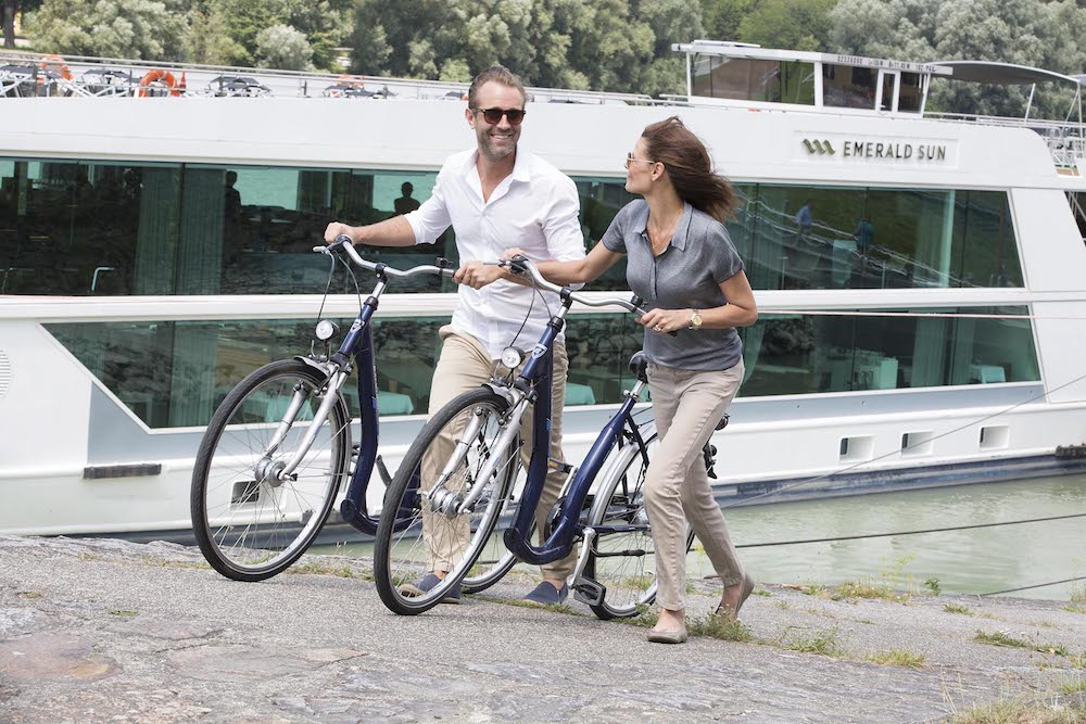 guests try out e-bikes on Emerald Waterways river cruise